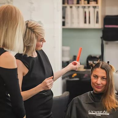Sydney hairdressers Deb Bradshaw and Tearne with client; hair stylists at the Balmain hairdressing salon, Hair Angel; former location in Rozelle; specialists in precision haircuts styling colour correction balayage treatments.