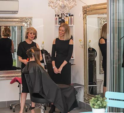 Australian hairdressers Tearne and Deb Bradshaw and client; stylists at the hairdressing salon Hair Angel; Darling St Balmain; previous location of Rozelle, inner west Sydney.