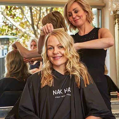 Australian hairdresser Deborah Bradshaw with client; blonde hair colourist specialist, stylist, proprietor of Balmain hairdressing salon Hair Angel; Darling St; prior Rozelle location, inner west Sydney, NSW.